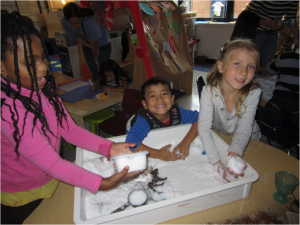 Playing with fake snow in a classroom sensory box