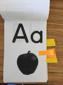 Our letter tracing books - known letters are marked with small Post-it notes.